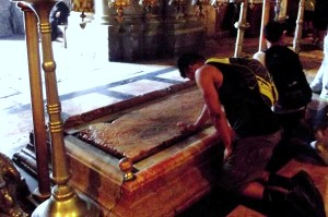 This is the Stone of Unction. Where Jesus' body was laid to wash and prepare it for burial.